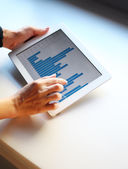 Image of human hand pointing at touchscreen with business graph — Stock Photo
