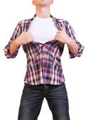Image of young man tearing his shirt off — Stock Photo