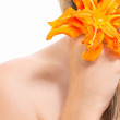 Girl with a flower of lily in her hair — Stock Photo #29352659