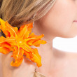 Orange lily in blond hair — Stock Photo #29352665