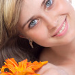 Portrait of a beautiful girl with a flower of lily — Stock Photo