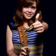 Teen recommends to play the guitar — Stock Photo