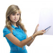 Girl shows something with a pen on a sheet of paper — Stock Photo