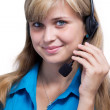 Girl operator in headphones communicate with customers — Stock Photo #29355111