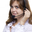 Girl operator in headphones communicate with customers — Stock Photo #29355153
