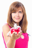 Beautiful girl advertises perfume in a red bottle — Stock Photo