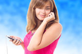 Beautiful girl with a mobile phone and headphones — Stock Photo