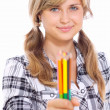 Stock Photo: Beautiful girl with color pencils in hands