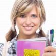 Stock Photo: Beautiful girl with color pencils and exercise books in hands
