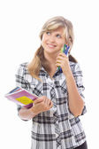 Beautiful girl with color pencils and exercise books in hands — Stock Photo