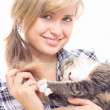 Beautiful girl plays with a kitten — Stock Photo #30717673