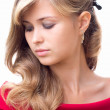 Beautiful girl with luxuriant hair and make-up — Stock Photo