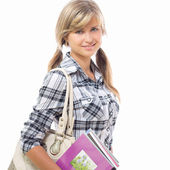 Beautiful girl with a notebook in hand — Stock Photo