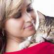 Beautiful girl with fluffy kitten on her shoulder — Stock Photo