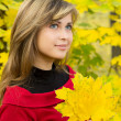 Stock Photo: Beautiful girl enjoying the autumn landscape