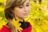 Beautiful girl with yellow maple leaves in her hair — Photo