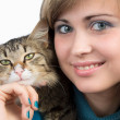Beautiful girl with fluffy kitten in her arms — Stock Photo
