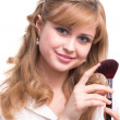 Portrait of a girl with a brush for makeup near her face — Stock Photo