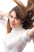 Active beautifu moving girl with luxurious flying hair — Stock Photo