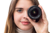 Portrait of beautiful girl with the lens near the eye — Stock Photo