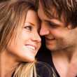 Romantic, tender moment of a young attractive couple. close up portrait — Stock fotografie