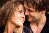Romantic, tender moment of a young attractive couple. close up portrait — ストック写真