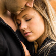 Romantic, tender moment of a young attractive couple. Pretty adorable girl closing her eyes — Стоковая фотография