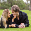 Happy young attractive couple portrait, smiling in outdoor environment — Stock Photo #29406977