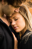 Romantic, tender moment of a young attractive couple. Pretty adorable girl closing her eyes — Stok fotoğraf