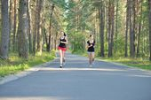Two woman Jogging in forest — Стоковое фото