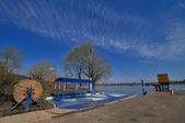 Ferry station on river — Stockfoto
