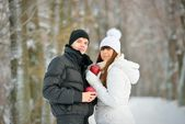 Couple with apples in winter forest — Stock Photo