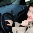 Woman behind wheel of car — Foto Stock