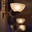Stock Photo: Classic sconce on wall
