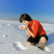Woman on snow field — Stock Photo