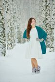 Woman in white dress in winter forest — Stock Photo