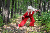 Woman in red suit of Japanese demon — Stock Photo