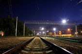 Rails of the railway at night — Stockfoto