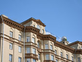 Building on background of blue sky — Stock Photo