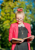 Beautiful young woman in glasses with book — Stok fotoğraf