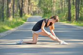 Woman doing sports stretching exercise — Stock Photo