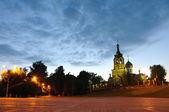 Night square and church illuminated — Foto de Stock