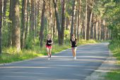 Two woman Jogging in forest — Stock Photo