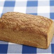 Bread on a checkered tablecloth — Stock Photo