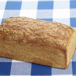Stock Photo: Bread on checkered tablecloth