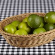 Basket of limes — Stock Photo