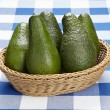 Basket of avocados — Stock Photo