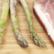 Green sparrowgrass and ham — Stock Photo