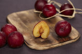 Plums on an old wooden board — Stock Photo