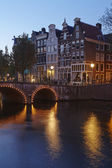 Amsterdam, Netherlands - Houses at a canal in the blue hour — Stock Photo